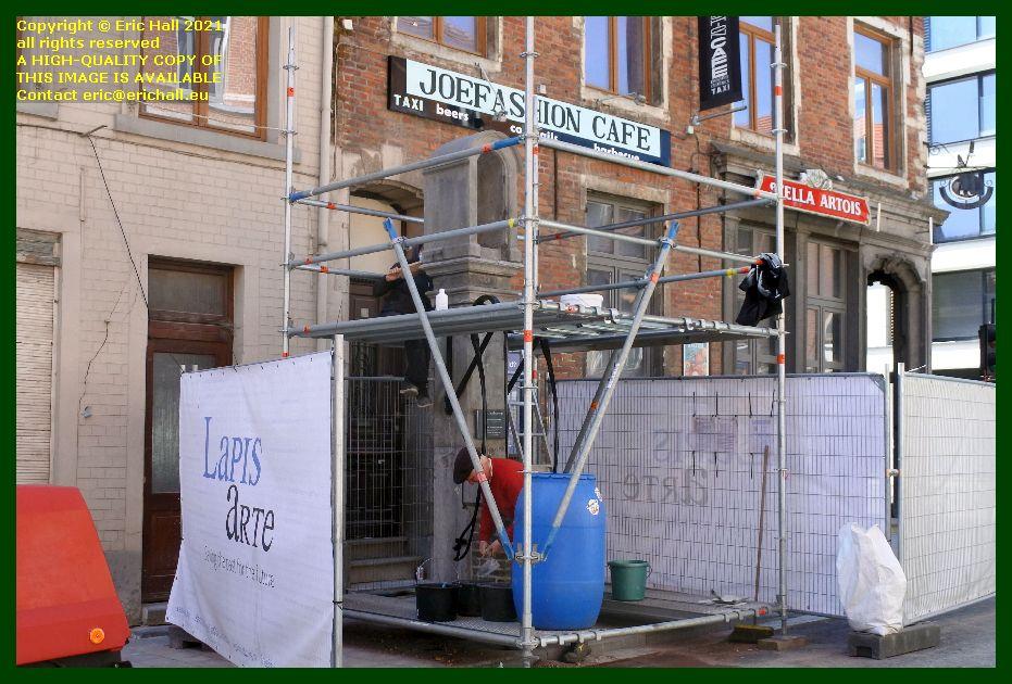 restoring old drinking fountain st hubertusstraat leuven belgium Eric Hall