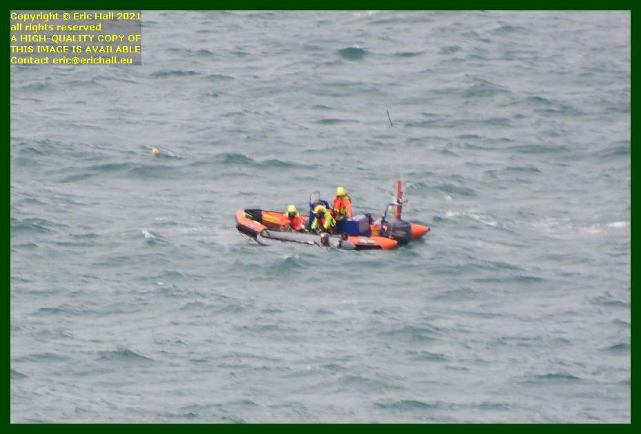 zodiac with small inflatable boat english channel Granville Manche Normandy France Eric Hall