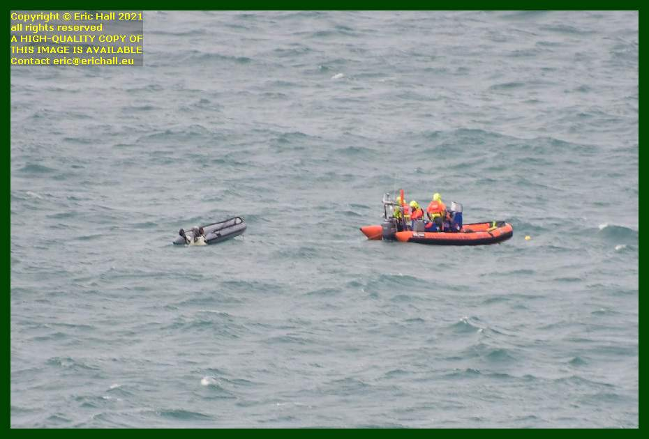 zodiac with small inflatable boat in tow Granville Manche Normandy France Eric Hall