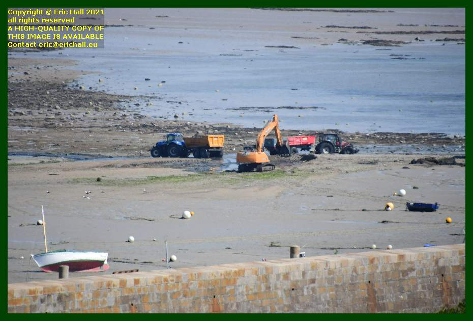 diggers working on entrance to port de Granville harbour Manche Normandy France Eric Hall