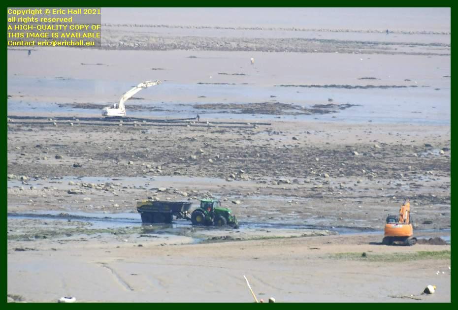 digging out harbour entrance port de Granville Manche Normandy France Eric Hall