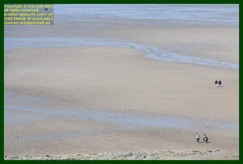 people on the beach rue du nord Granville Manche Normandy France Eric Hall