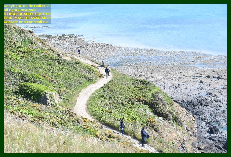 people on lower footpath pointe du roc Granville Manche Normandy France Eric Hall