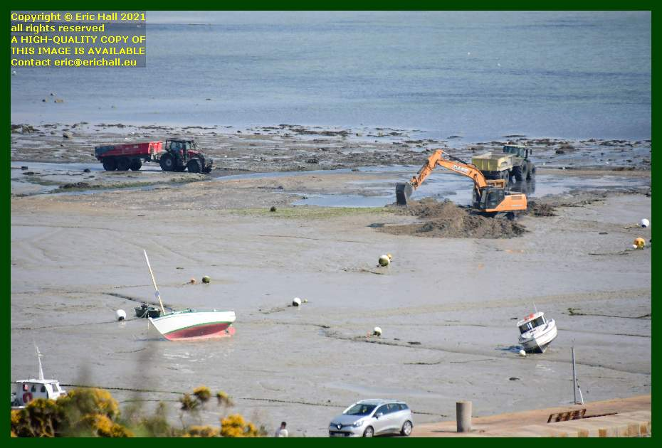 digger with tractors and trailers port de Granville harbour Manche Normandy France Eric Hall