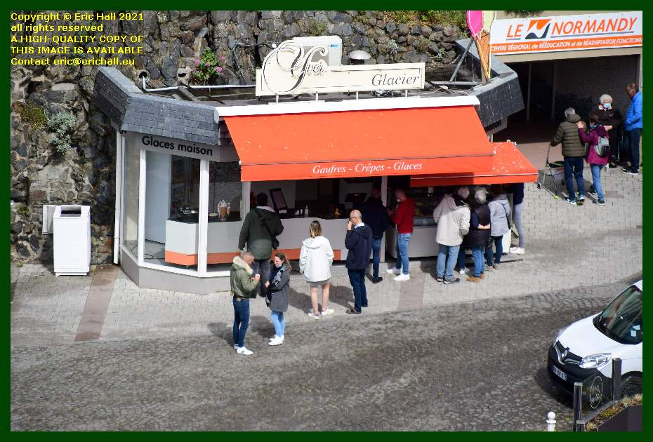 people eating gaufres crepes and ice cream place marechal foch Granville Manche Normandy France Eric Hall