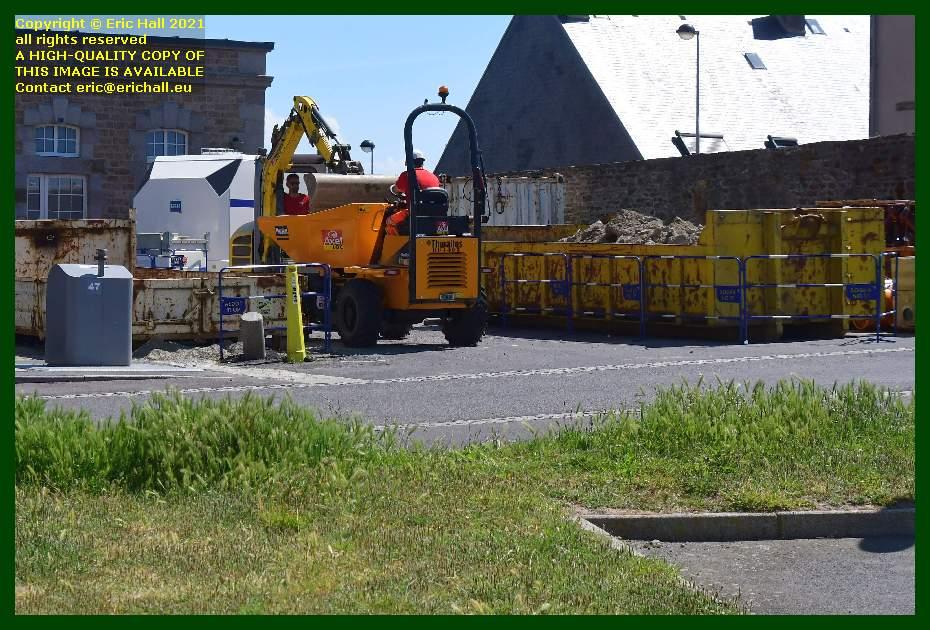 workmen building compound place d'armes Granville Manche Normandy France Eric Hall