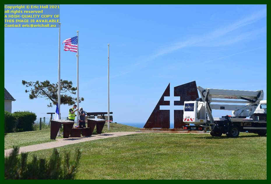 fixing flags to flagpoles pointe du roc Granville Manche Normandy France Eric Hall