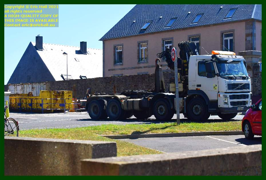 volvo skip lorry collecting skip place d'armes Granville Manche Normandy France Eric Hall