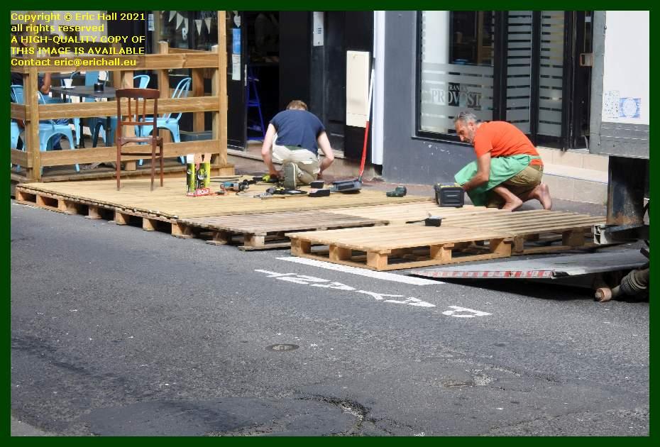 workmen preparing base of terrace rue couraye Granville Manche Normandy France Eric Hall