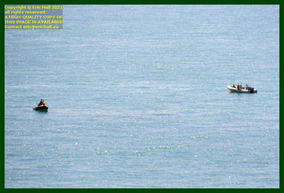 men fishing from zodiacs baie de Granville Manche Normandy France Eric Hall