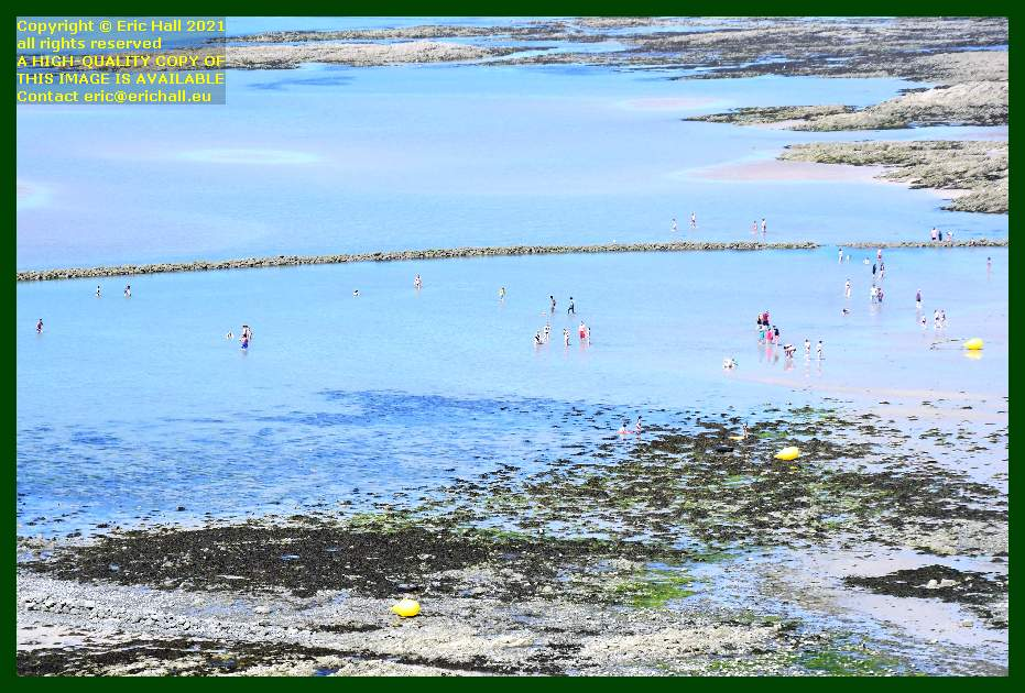 people swimming in medieval fish trap plat gousset Granville Manche Normandy France Eric Hall