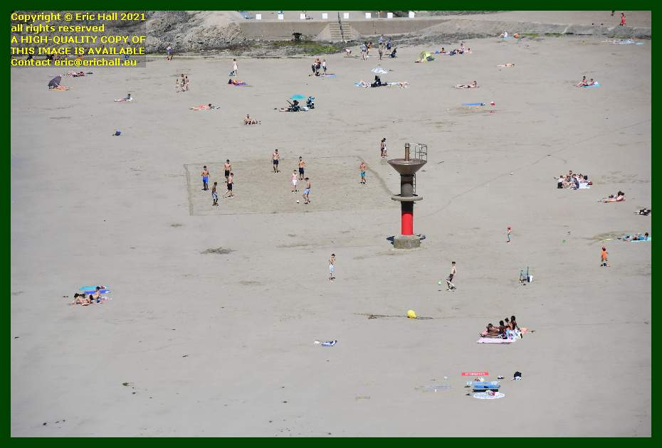 people playing football sunbathing on beach plat gouseet Granville Manche Normandy France Eric Hall