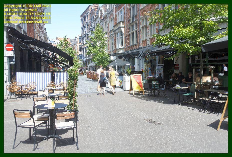 people at tables in street tienestraat Leuven Belgium Eric Hall
