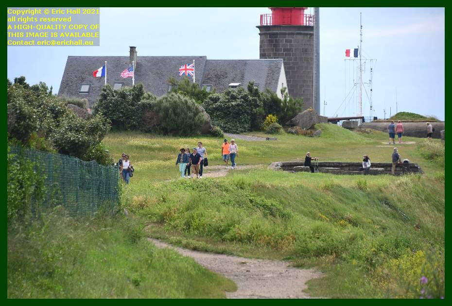 crowds of people on footpath british flag pointe du roc Granville Manche Normandy France Eric Hall