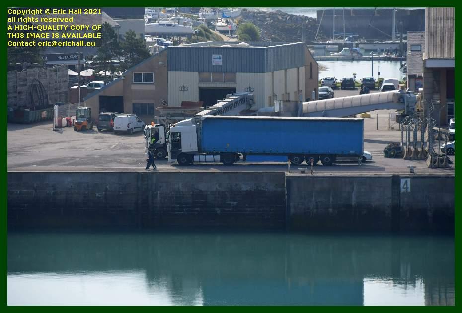 lorries unloading at quayside port de Granville harbour Manche Normandy France Eric Hall