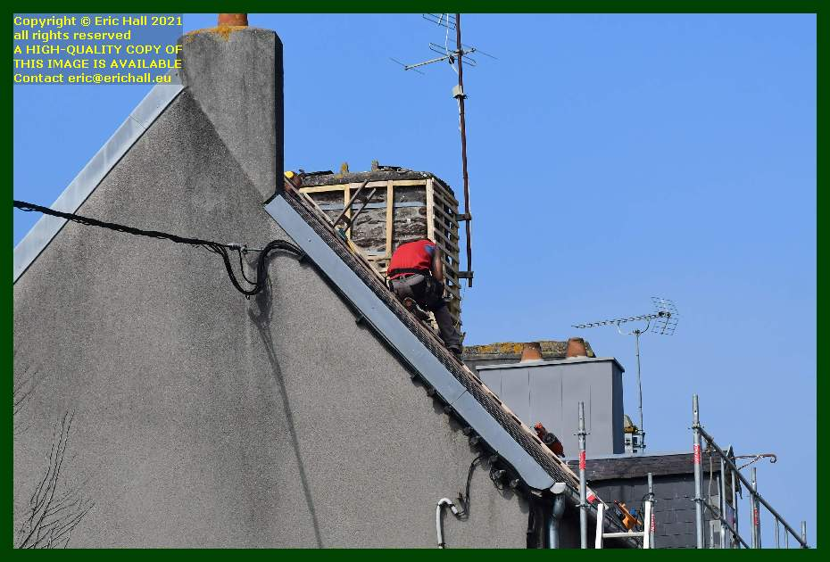 roofers fitting laths around chimney rue de la houle Granville Manche Normandy France Eric Hall
