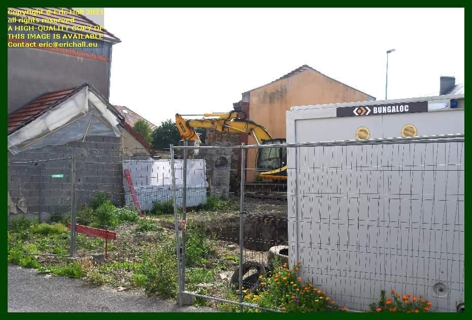 digger building site rue st paul rue victor hugo Granville Manche Normandy France Eric Hall