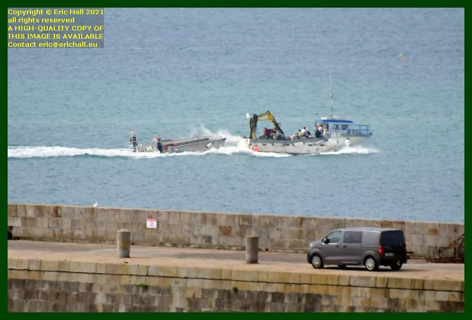 fishing boat towing dinghy baie de mont st michel Granville Manche Normandy France Eric Hall
