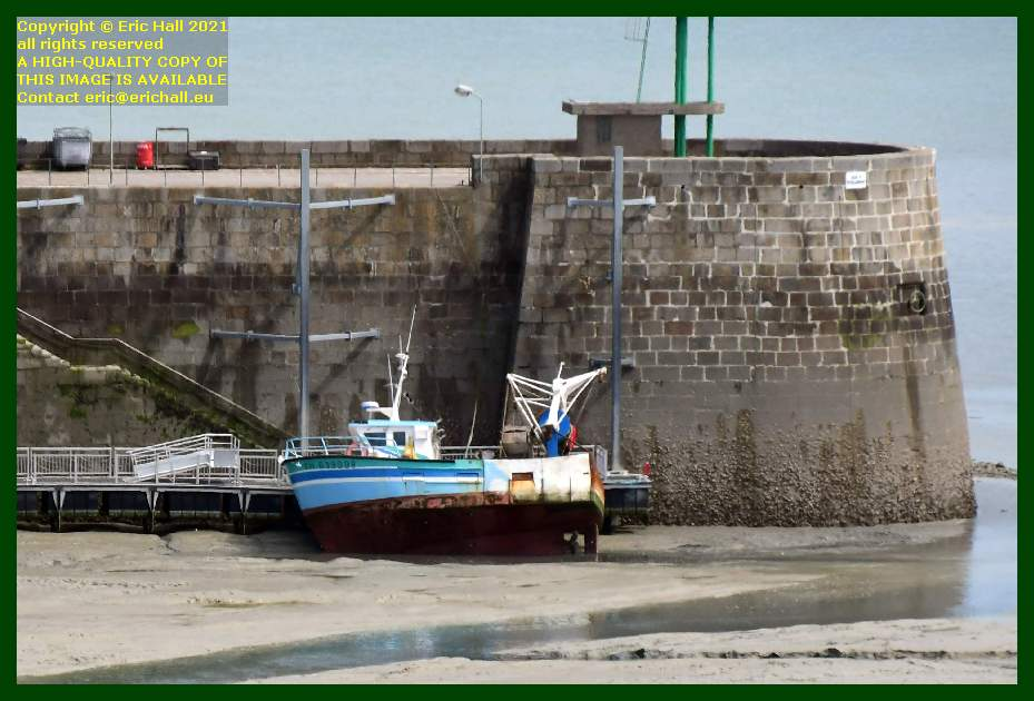 fishing boat aground ferry terminal port de Granville harbour Manche Normandy France Eric Hall