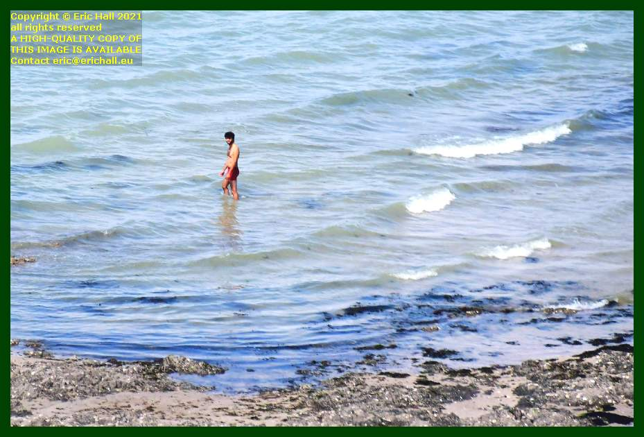 person in sea beach rue du nord Granville Manche Normandy France Eric Hall