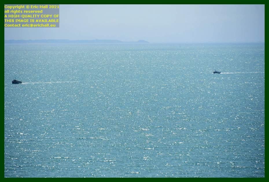 fishing boats entering baie de mont st michel coming to port de Granville harbour Manche Normandy France Eric Hall