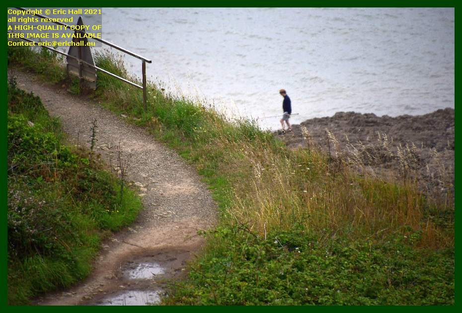 boy finishing fishing pointe du roc Granville Manche Normandy France Eric Hall