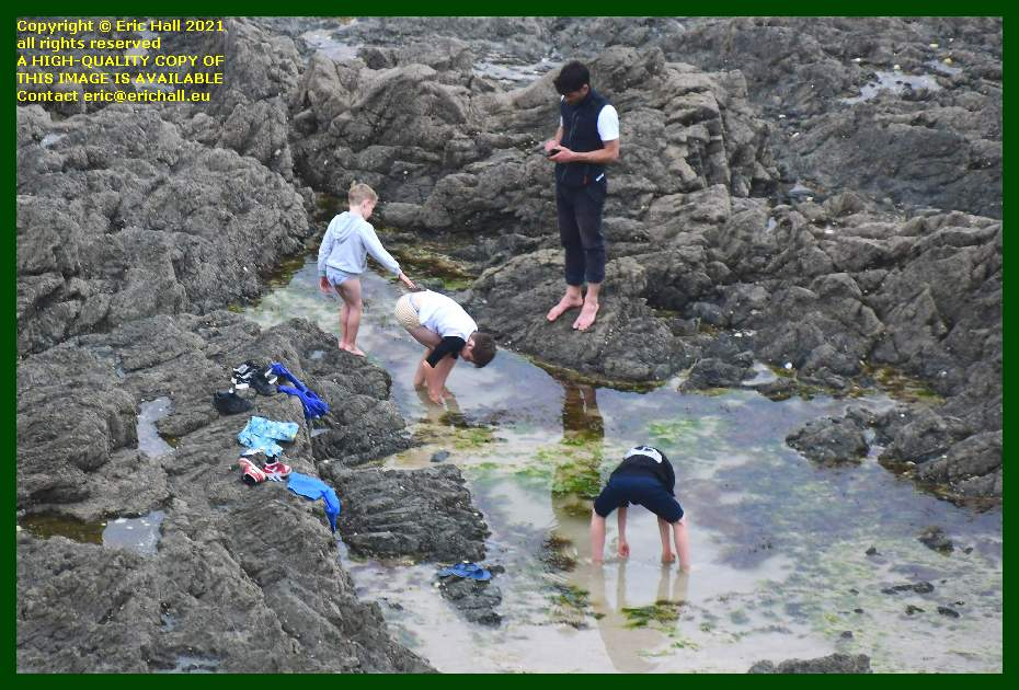 people fishing in rock pool beach rue du nord Granville Manche Normandy France Eric Hall