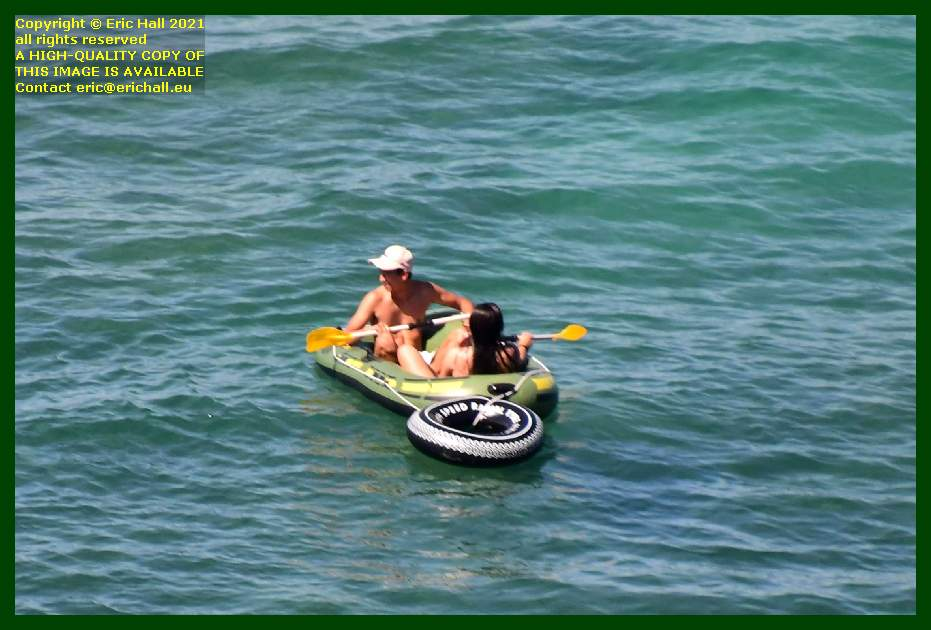 man and woman on inflatable boat baie de Granville Manche Normandy France Eric Hall