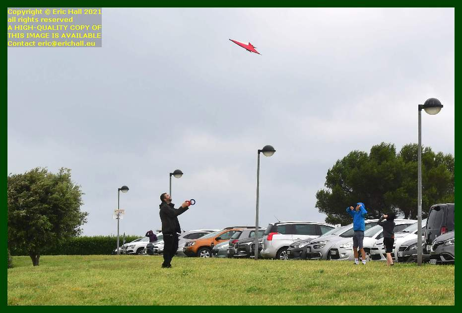 man with kids flying kite boulevard vaufleury Granville Manche Normandy France Eric Hall