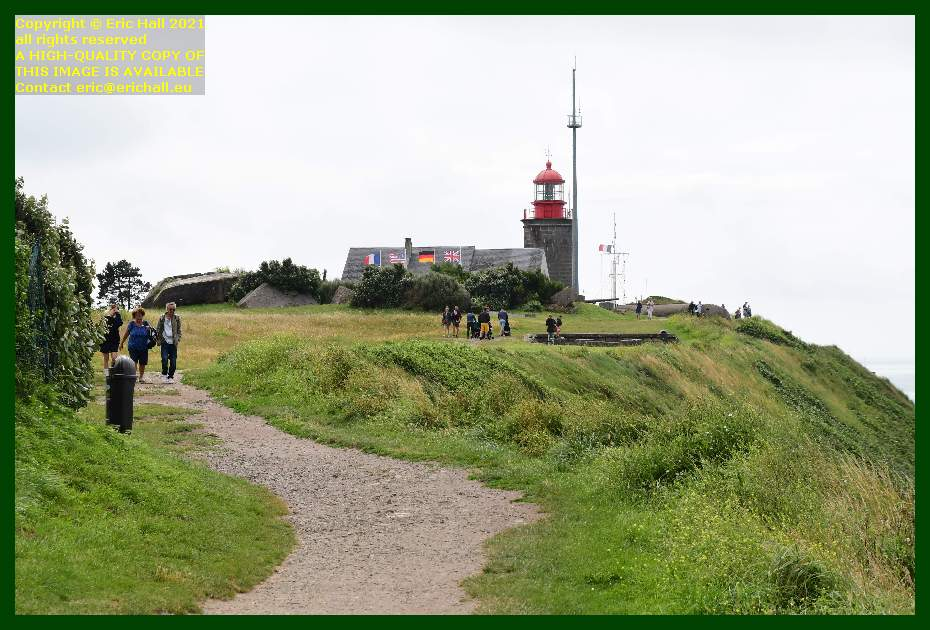 crowds of people on path near lighthouse semaphore station pointe du roc Granville Manche Normandy France Eric Hall