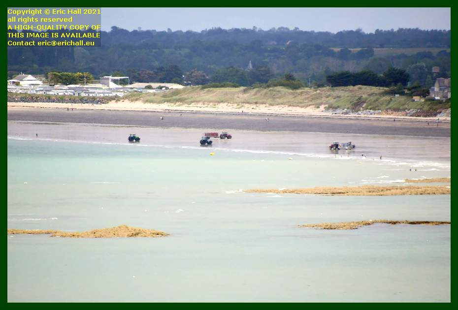 tractors people on beach donville les bains Manche Normandy France Eric Hall