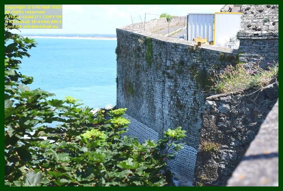 repairing city walls rue du marché aux chevaux Granville Manche Normandy France Eric Hall