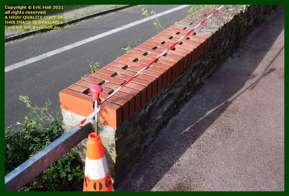 repairing brick wall Boulevard des 2E et 202E de Ligne Granville Manche Normandy France Eric Hall