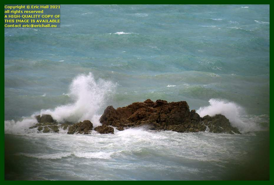 waves breaking on rocks baie de Granville Manche Normandy France Eric Hall