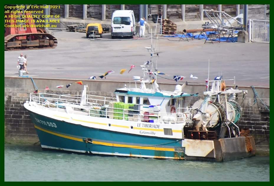 man in hazmat gear le tiberiade port de Granville harbour Manche Normandy France Eric Hall