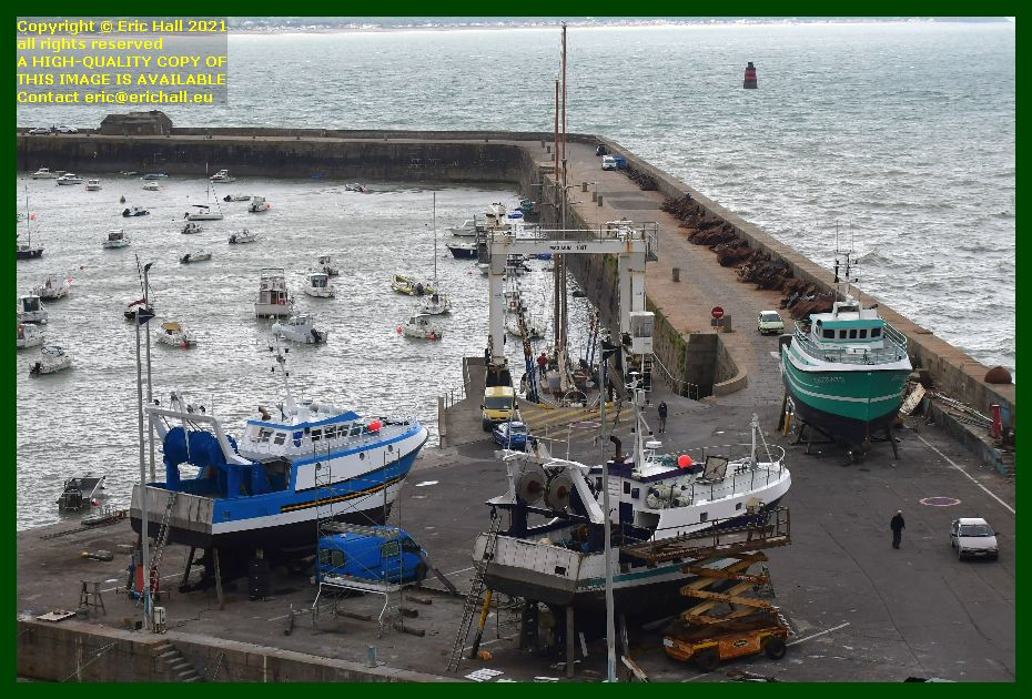 trawler charlevy yacht rebelle going back into the water chantier naval port de Granville harbour Manche Normandy France Eric Hall