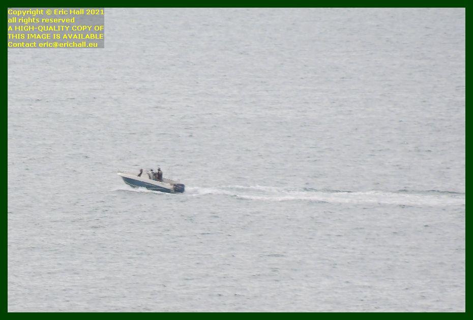 fishermen in speedboat baie de Granville Manche Normandy France Eric Hall