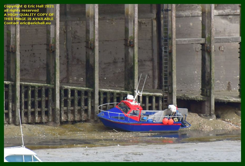 small boat aground port de Granville harbour Manche Normandy France Eric Hall