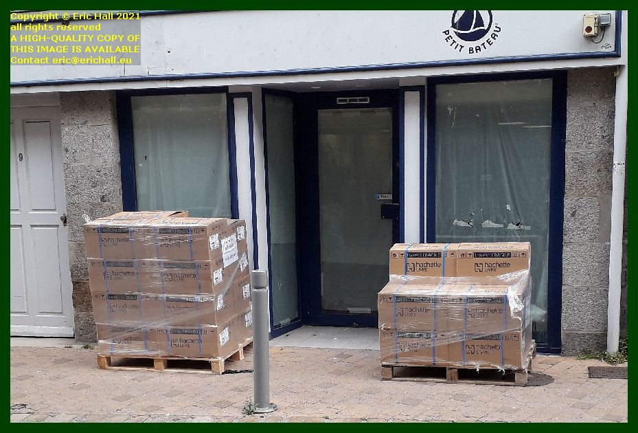 unloading goods at empty shop rue couraye Granville Manche Normandy France Eric Hall