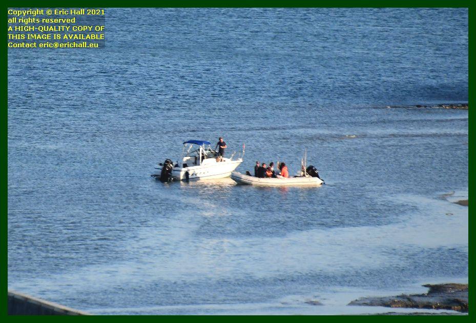fishermen in speedboat zodiac loitering outside port de Granville harbour Manche Normandy France Eric Hall