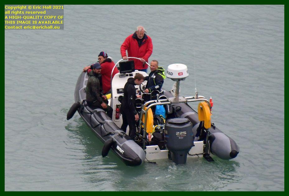 people on board zodiac leaving port de Granville harbour Manche Normandy France Eric Hall