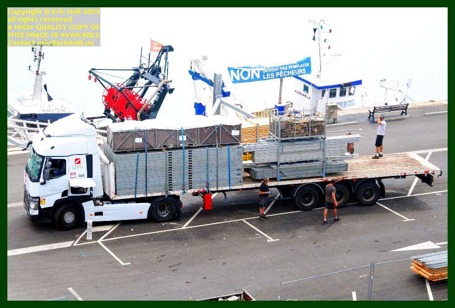 removing equipment from festival des voiliers du travail rue du port Granville Manche Normandy France Eric Hall