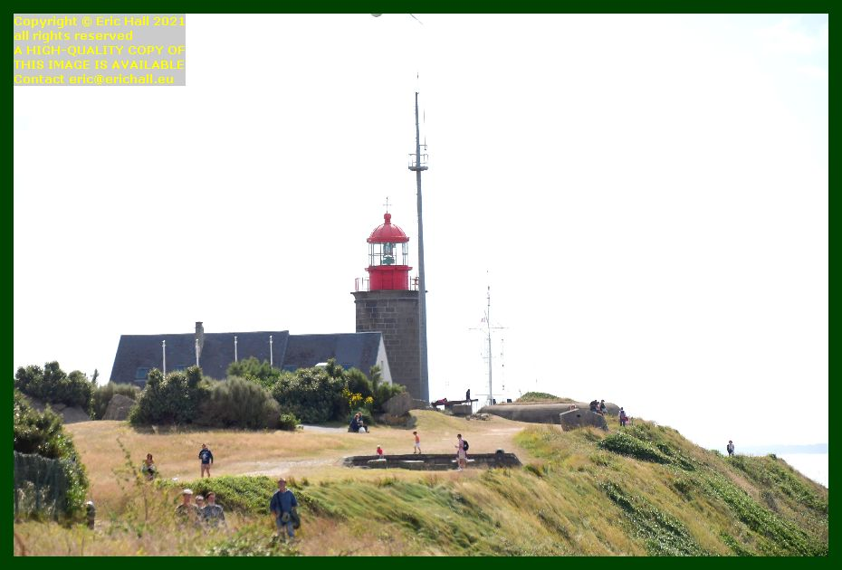 lighthouse semaphore crowds on footpath pointe du roc Granville Manche Normandy France Eric Hall