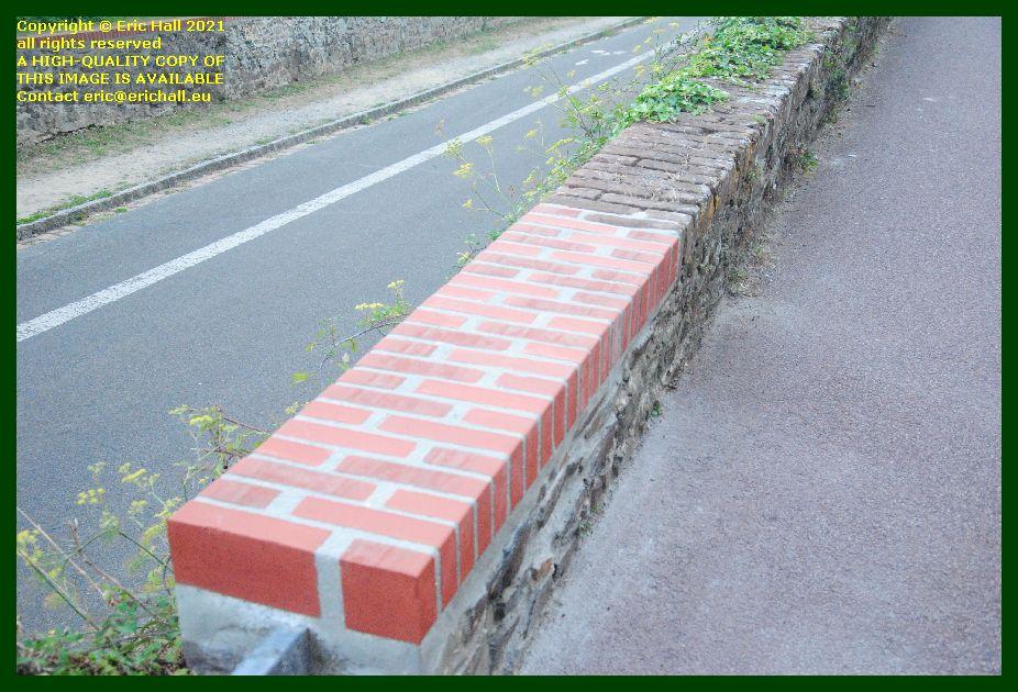 repaired wall Boulevard des 2E et 202E de Ligne Granville Manche Normandy France Eric Hall photo September 2021