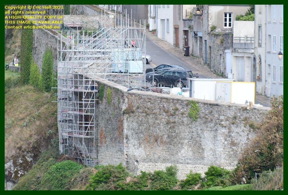 repairing medieval city walls place du marché aux chevaux Granville Manche Normandy France Eric Hall photo September 2021