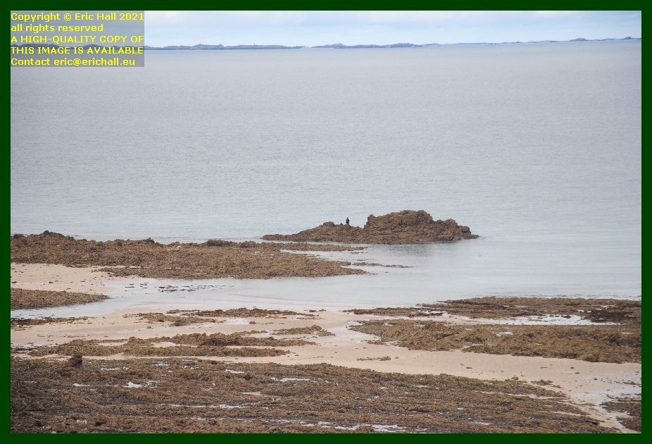 ile de chausey man fishing from rocks baie de Granville Manche France photo Eric Hall September 2021