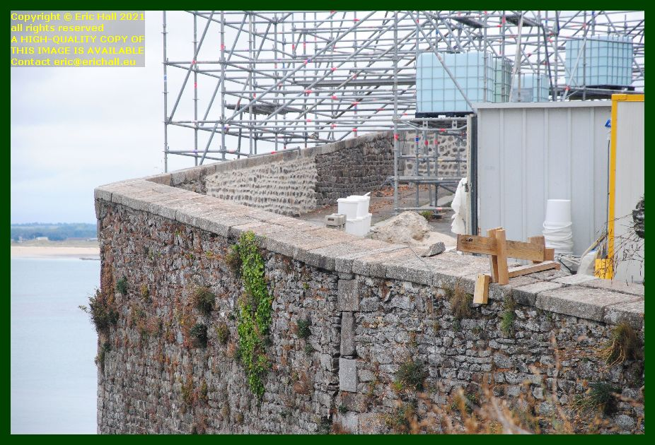 scaffolding repairing medieval city walls place du marché aux chevaux Granville Manche Normandy France Eric Hall photo September 2021