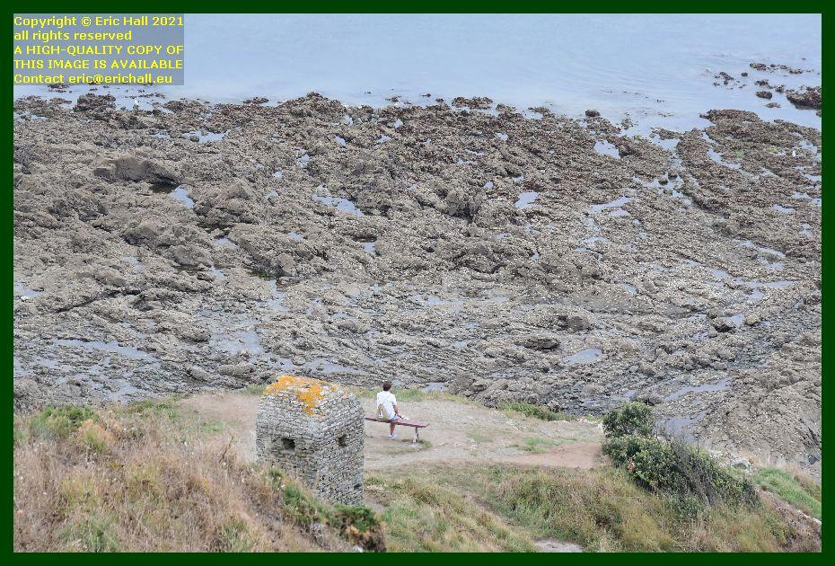 cabanon vauban person sitting on bench pointe du roc Granville Manche Normandy France Eric Hall photo September 2021