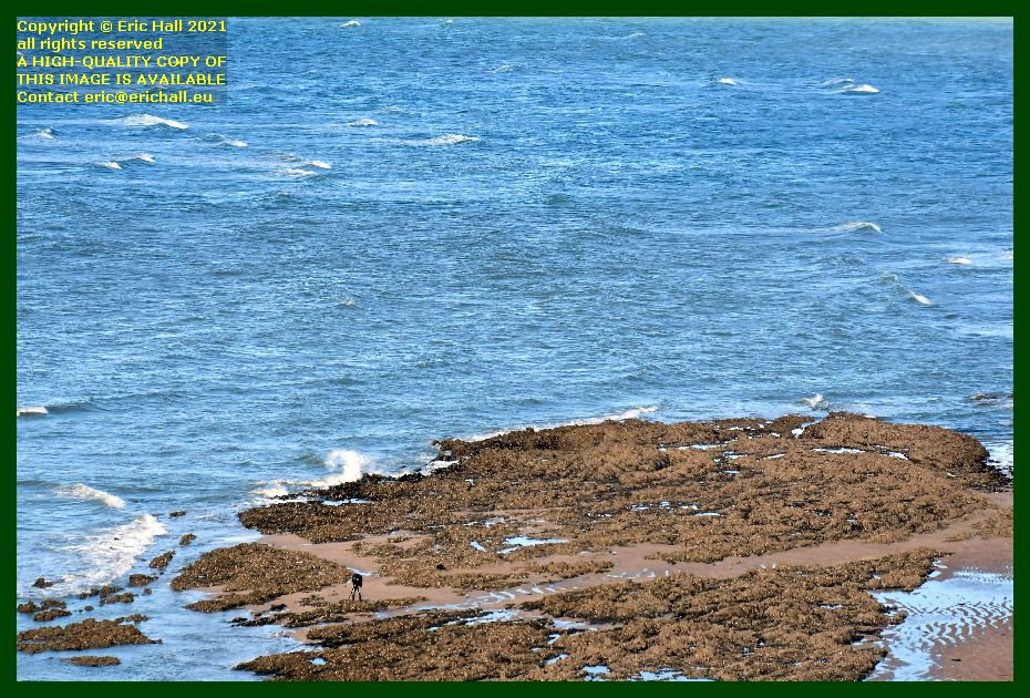 waves man on beach rue du nord Granville Manche Normandy France Eric Hall photo September 2021