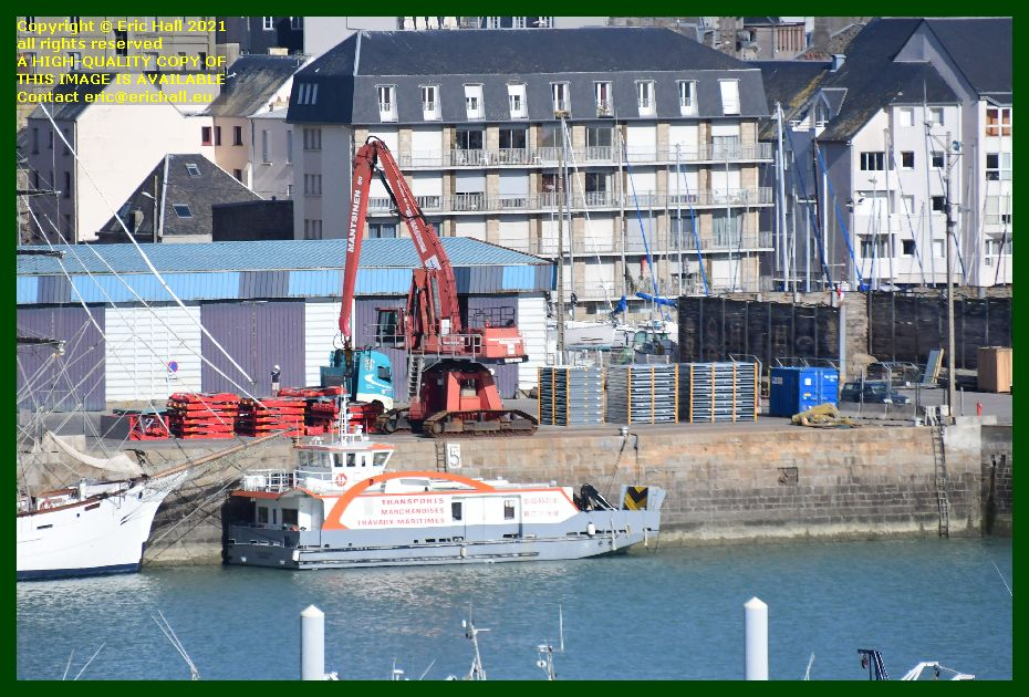 crane unloading freight on quayside port de Granville harbour Manche Normandy France Eric Hall photo September 2021